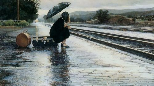 Waiting for a train in the rain